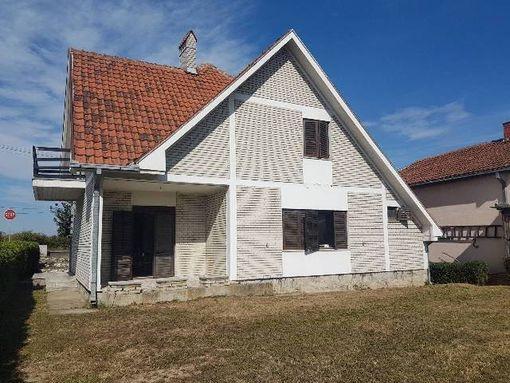 Kvalitetna porodična kuća sa poslovnim prostorom - slika 2